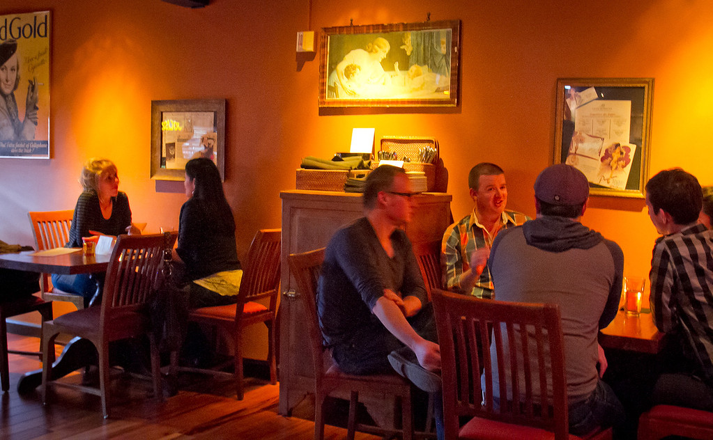 Customers enjoy drinks during Happy Hour at the Honor Bar in Emeryville,  Calif., on Friday, March 23rd, 2012.