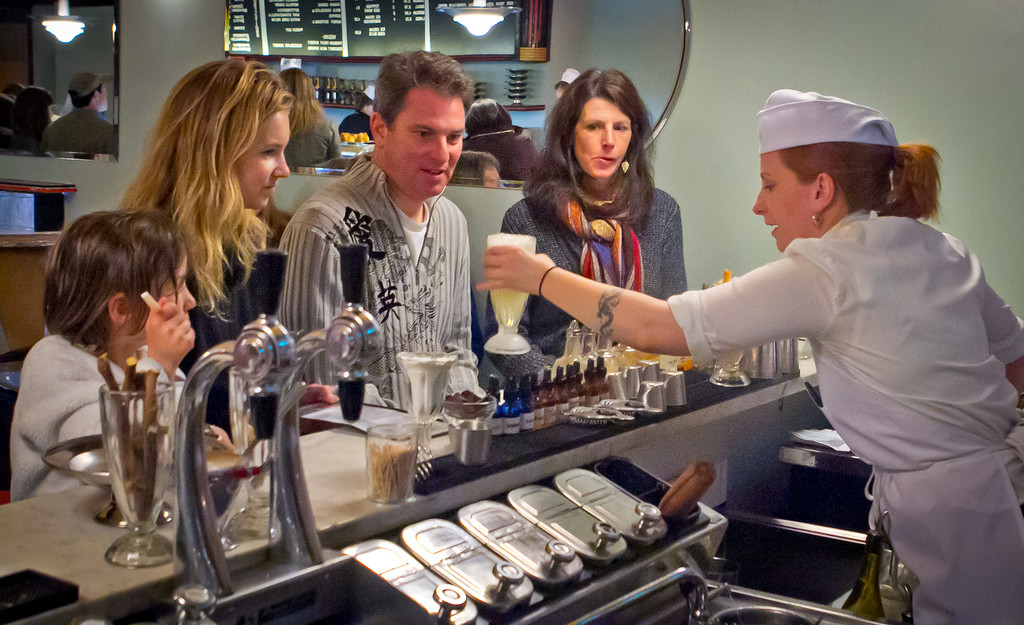 Soda jerk Keli Rivers serves customers a soda at the Ice Cream Bar in San Francisco,  Calif., on Saturday, March 10th, 2012.