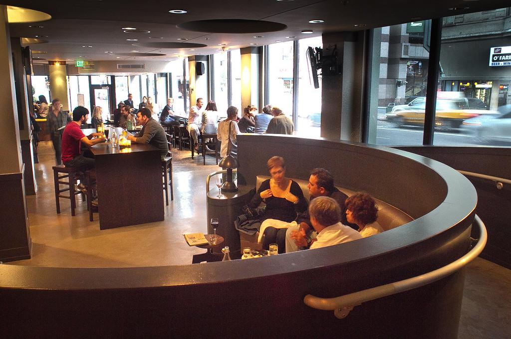 Diners enjoy drinks in the bar at Jasper's Corner Tap & Kitchen in San Francisco, Calif., on Friday, September 23rd, 2011.