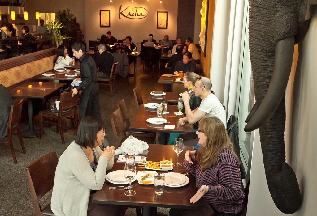 Diners enjoy dinner at Kacha Thai Bistro in Walnut Creek, Calif., on Friday April 7th, 2012.