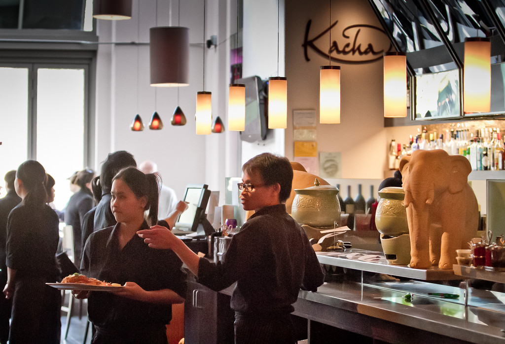 Servers take food to tables at Kacha Thai Bistro in Walnut Creek, Calif., is seen on Friday April 7th, 2012.