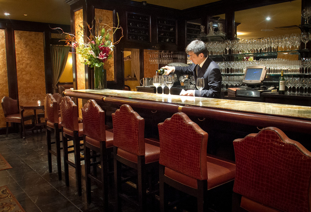 Co-Owner Seigo Takei pours wine at the bar at Keiko Restaurant in San Francisco, Calif., on Friday, January 20th, 2012.