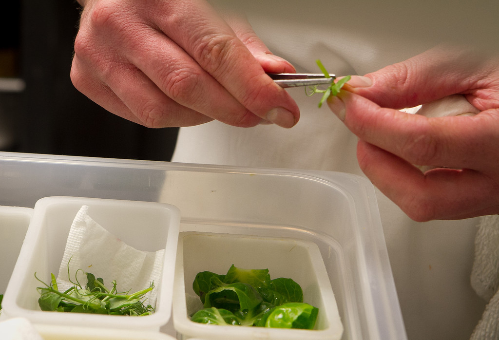 A chef prepares micro greens at Keiko Restaurant in San Francisco, Calif., on Friday, January 20th, 2012.