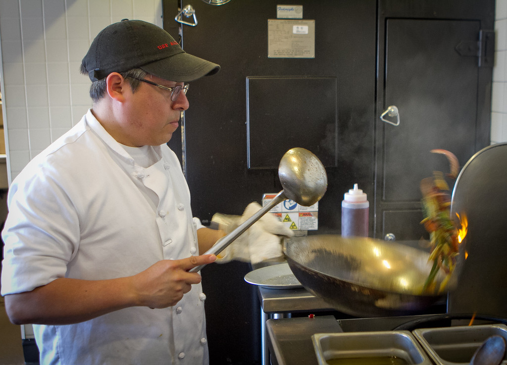 Chef Alex Reccio stir frys vegetables at Limon Rotisserie in San Francisco, Calif., on Thursday, October 18th, 2012.