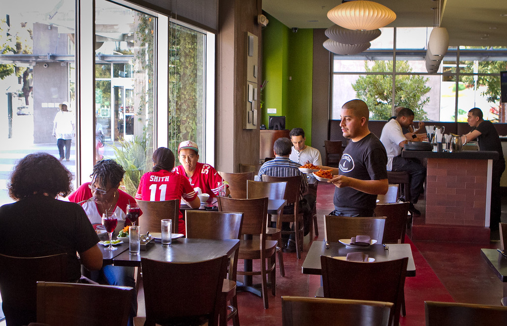People enjoy lunch at Limon Rotisserie in San Francisco, Calif., on Thursday, October 18th, 2012.