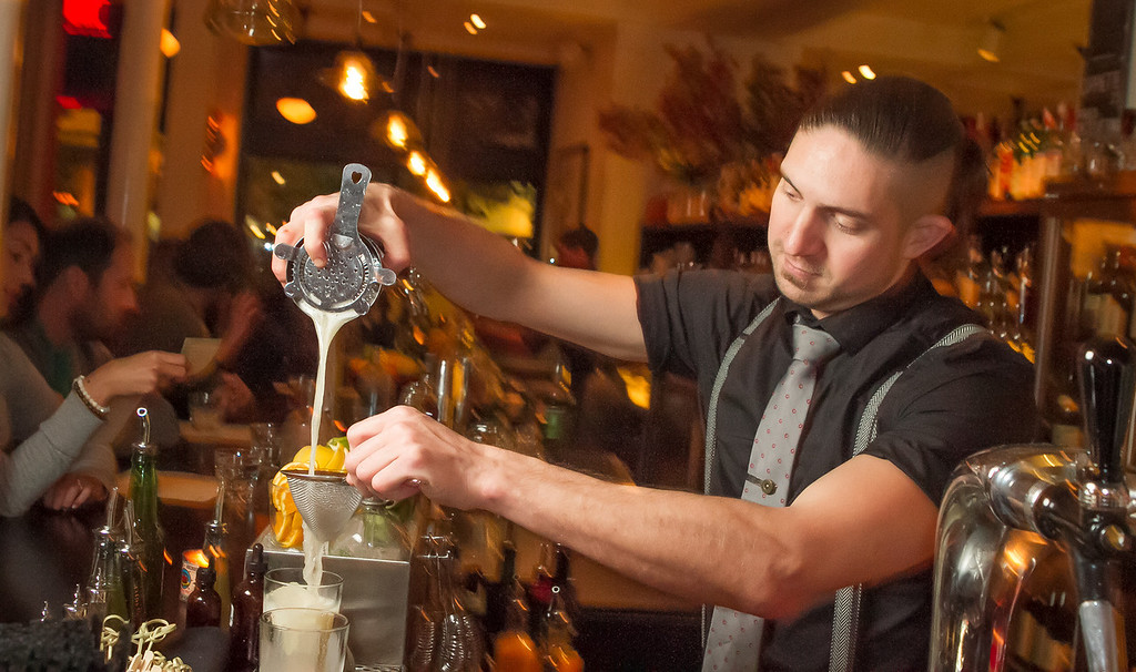 Bartender Aaron London pours a cocktail at Locanda in San Francisco, Calif., on Friday, November 23rd, 2012.