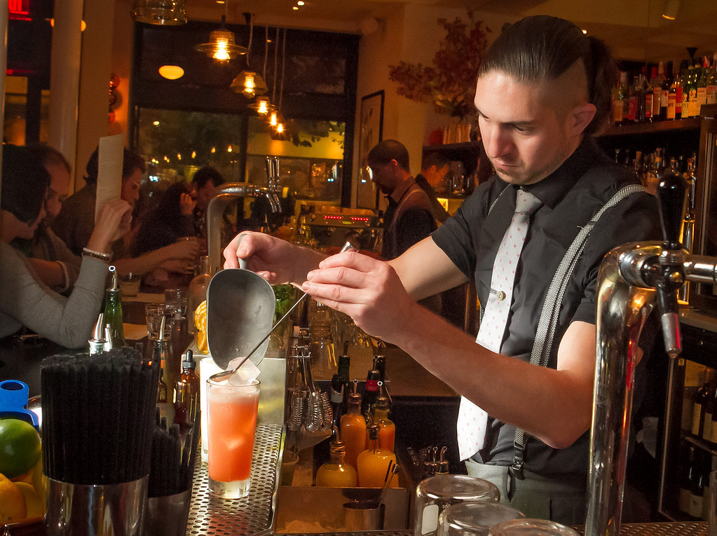 Bartender Aaron London adds ice to a cocktail at Locanda in San Francisco, Calif., on Friday, November 23rd, 2012.