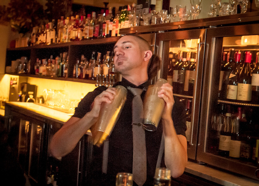 Bartender Aaron London shakes cocktails at Locanda in San Francisco, Calif., on Friday, November 23rd, 2012.