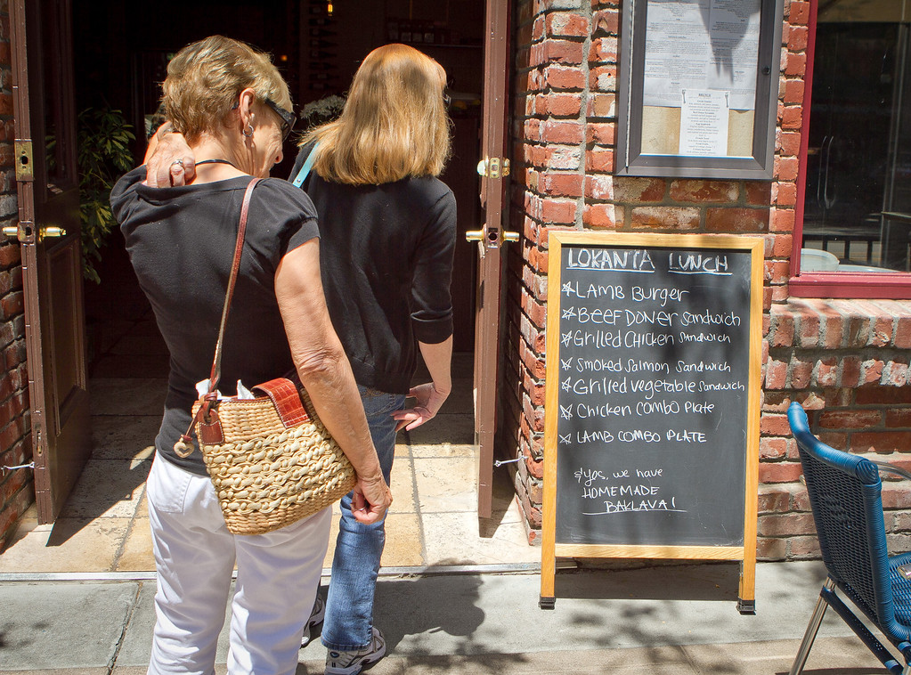 Customers view the specials board at Lokanta restaurant in Pleasanton, Calif., on Friday, June 15th, 2012.