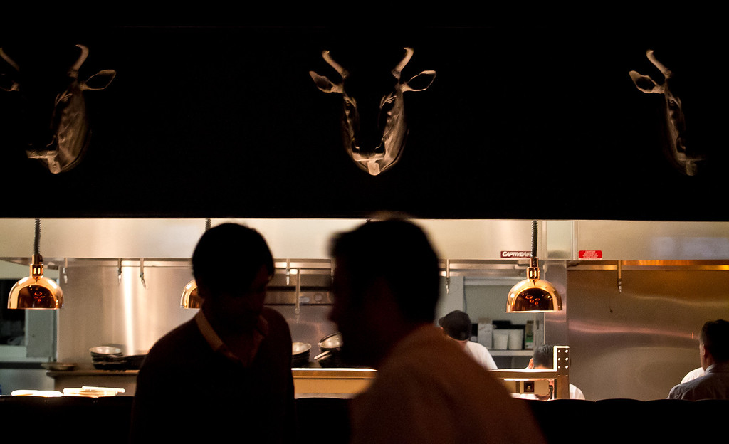 The steer heads above the kitchen at Lolinda Steakhouse in San Francisco, Calif., is seen on Friday, October 19th, 2012.