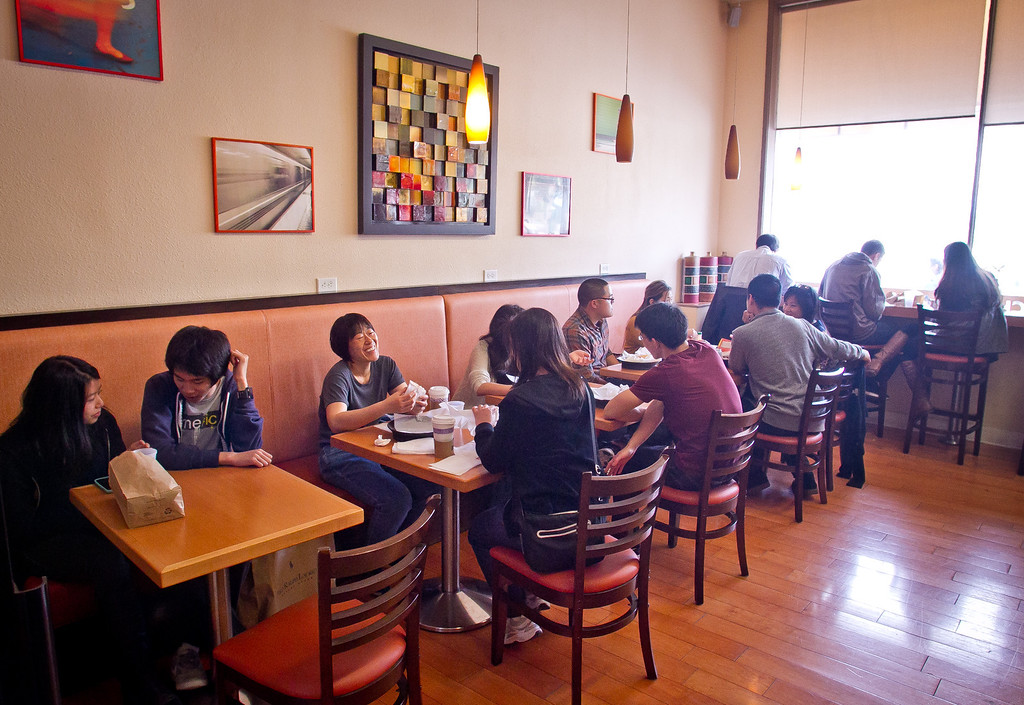 Diners enjoy sandwiches inside of Lou's Cafe in San Francisco on Friday, September 14th, 2012.