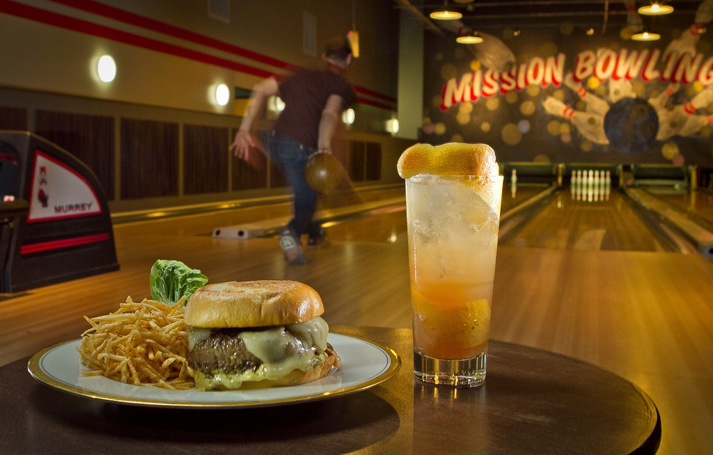 "The Mission Burger with Home Fries and the ""Cooler"" cocktail at  Mission Bowling Club in San Francisco, Calif., is seen on Friday, May 11th, 2012."