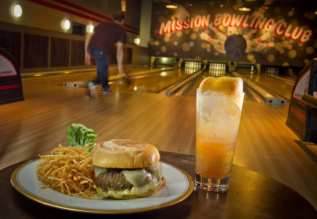 """The Mission Burger with Home Fries and the """"Cooler"""" cocktail at  Mission Bowling Club in San Francisco, Calif., is seen on Friday, May 11th, 2012."""