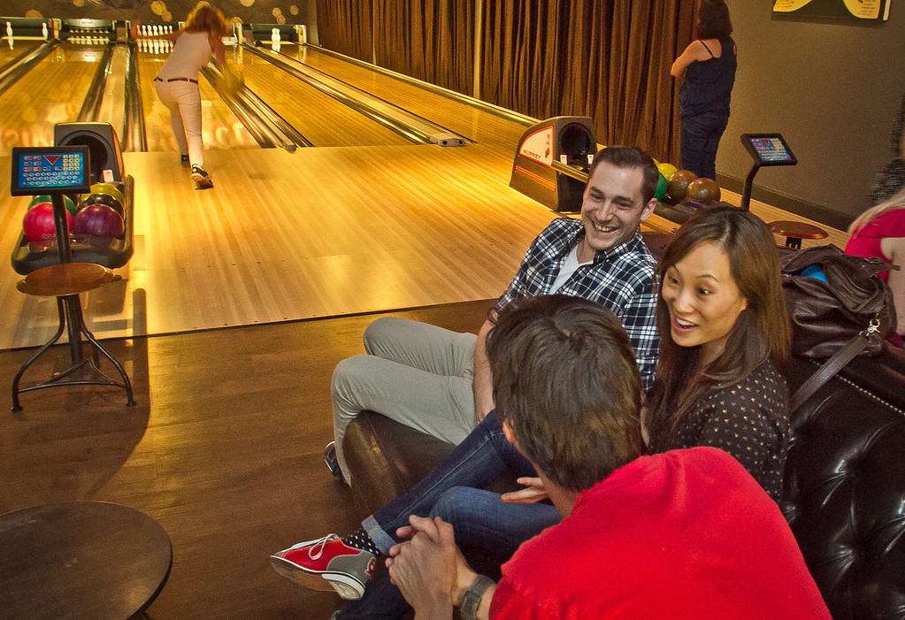 People relax on couches as their friend bowls at the  Mission Bowling Club in San Francisco, Calif., on Friday, May 11th, 2012.