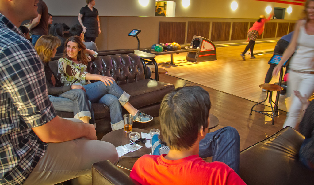 People relax on couches while their friends bowl at the Mission Bowling Club in San Francisco, Calif., on Friday, May 11th, 2012.