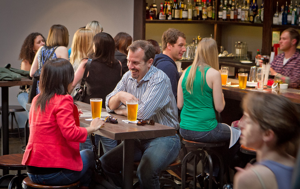 People enjoy happy hour at the Mission Bowling Club in San Francisco, Calif., on Friday, May 11th, 2012.