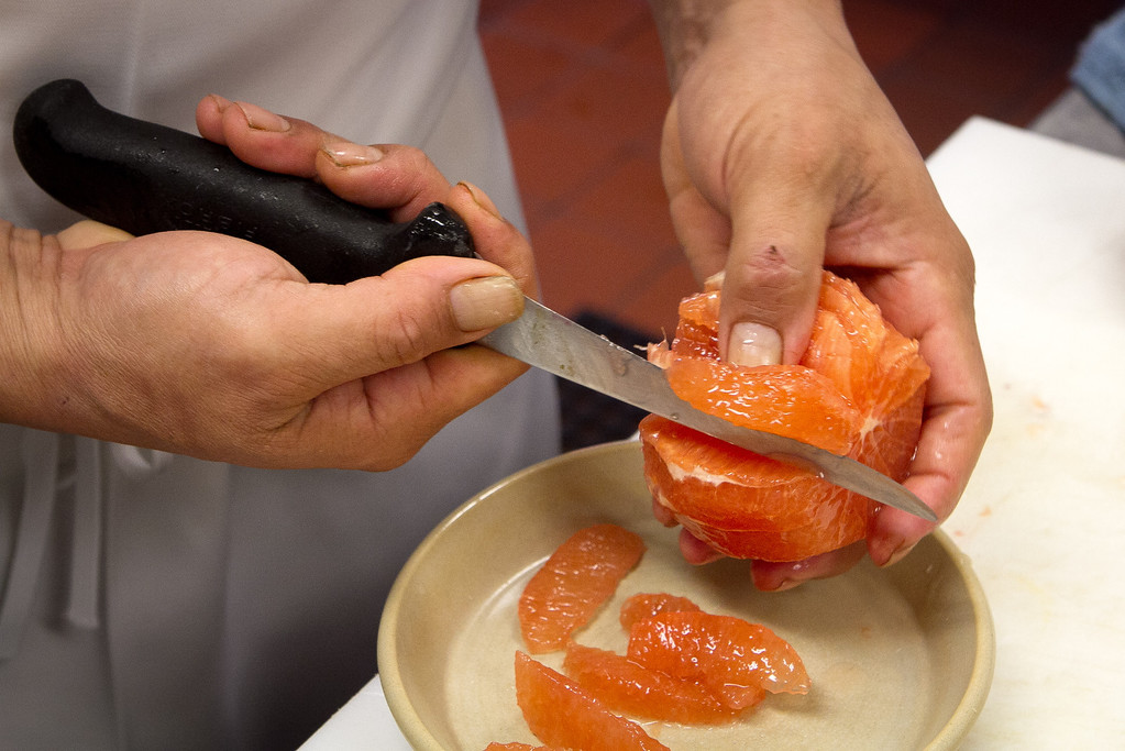 Grapefruit being cut by Chef Mateo Granados for the preparation of Monkey Face Eel at Mateo's Cocina Latina in Healdsburg, Calif., on Sunday, February 26th, 2012.