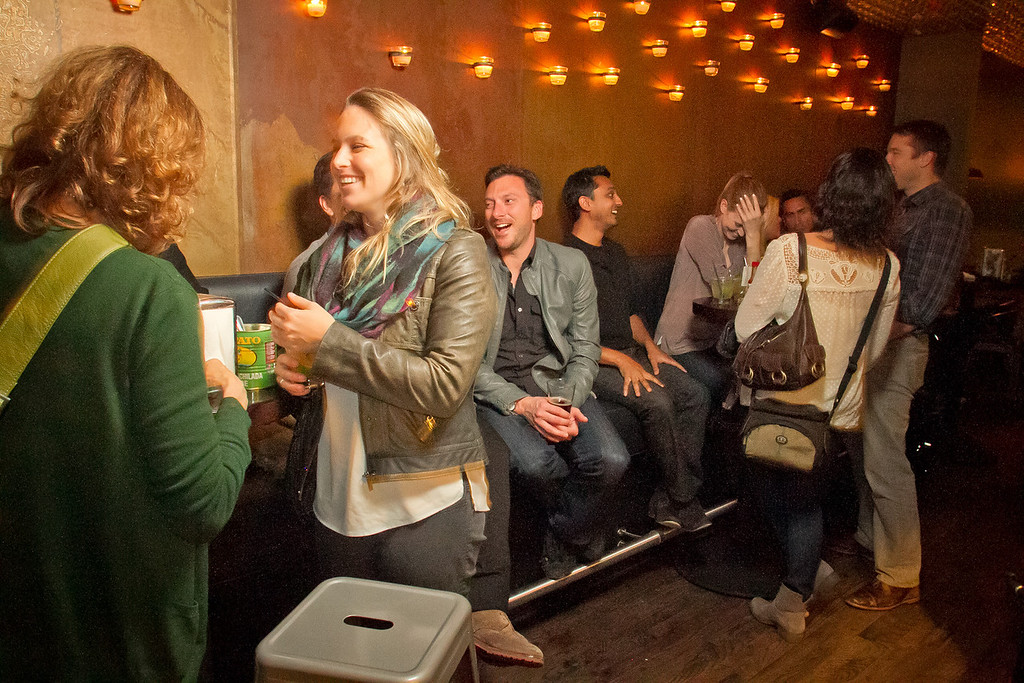 People have cocktails and Tacos at Mosto Bar in San Francisco, Calif., on Friday, November 2nd, 2012.