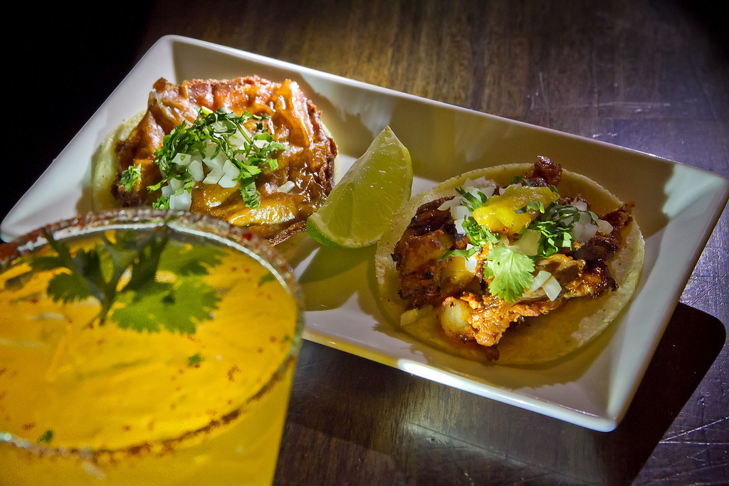 A Taco al Pastor and a Taco el Califa with Hacienda de Chihuahua cocktail at Mosto Bar in San Francisco, Calif., is seen on Friday, November 2nd, 2012.