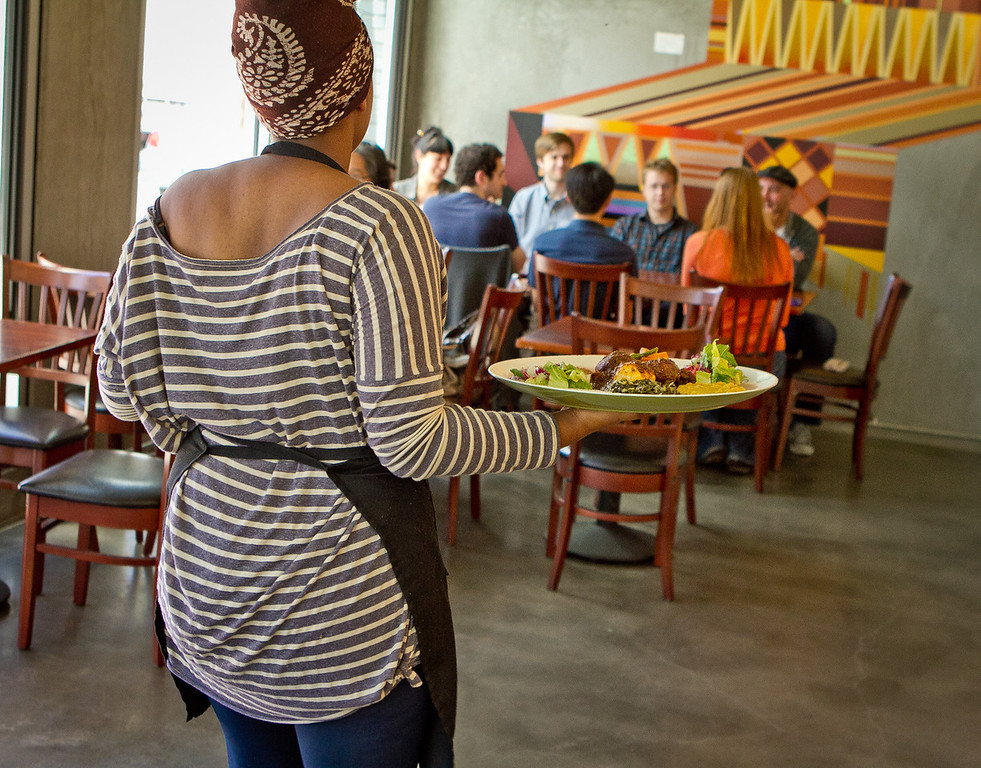 Food makes it way out of the kitchen for lunch at Moya Ethiopian Eatery & Cafe in San Francisco, Calif., is seen Thursday, July 18th, 2012.