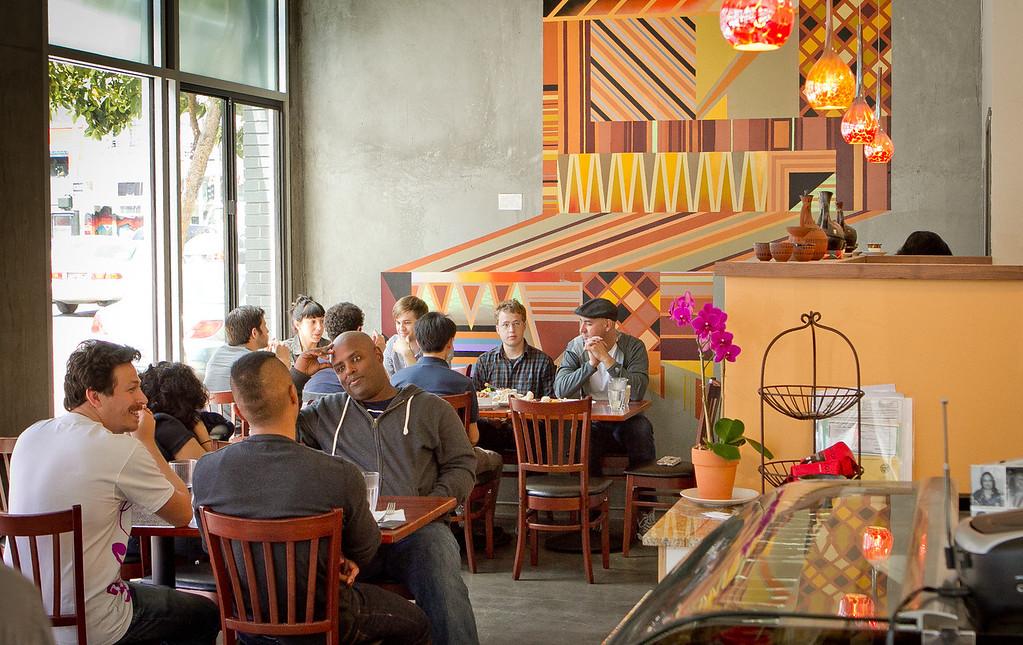 People enjoy lunch at Moya Ethiopian Eatery & Cafein San Francisco, Calif., Thursday, July 18th, 2012.