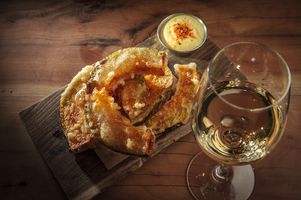 """The fried Kabocha Squash with a glass of Jo Landron's, """"Atmouspheres"""" Sparkling Wine at Namu Gaji in San Francisco, Calif. is seen on Thursday, January 3rd, 2013."""