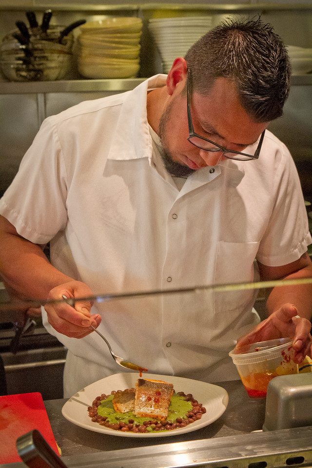 Chef Jose Ramos sauces the seared Trout at Nopalito in San Francisco, Calif., on Saturday, October 27th, 2012.
