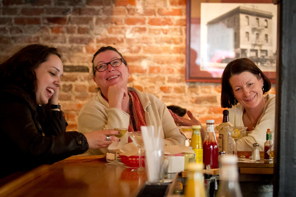 Customers enjoy Happy Hour at the Old Ship Saloon in San Francisco, Calif., on Monday April 2nd, 2012.
