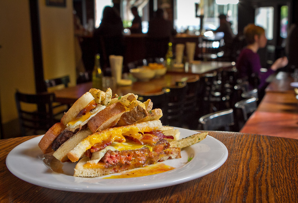 """The Curly""  hamburger with bacon, fried egg and cheddar cheeses at the Old Ship Saloon in San Francisco, Calif., is seen on Monday April 2nd, 2012."