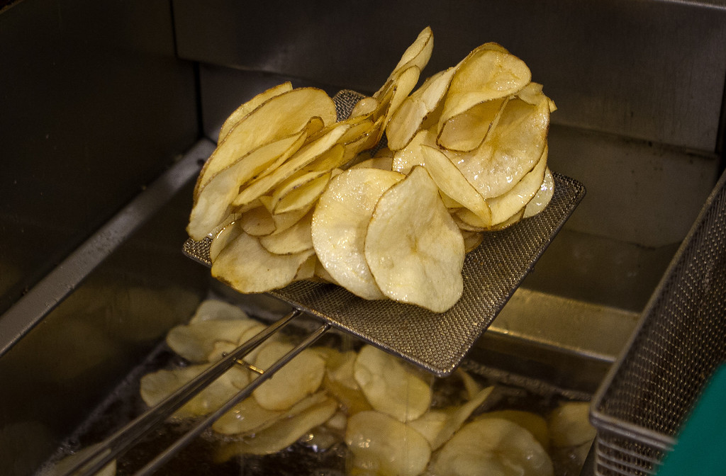 Home made Potato Chips come out of the fryer at the Old Ship Saloon in San Francisco, Calif., on Monday April 2nd, 2012.