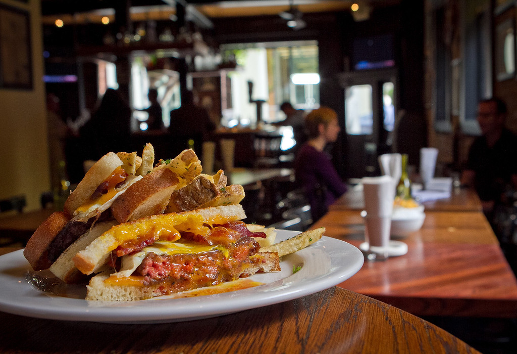 """""""The Curly""""  hamburger with bacon, fried egg and cheddar cheeses at the Old Ship Saloon in San Francisco, Calif., is seen on Monday April 2nd, 2012."""