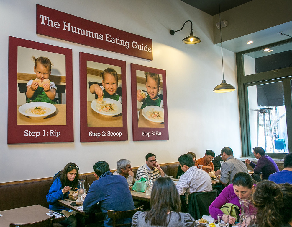Diners enjoy lunch at Oren's Hummus Shop in Palo Alto Calif. on Friday, January 25th, 2013.