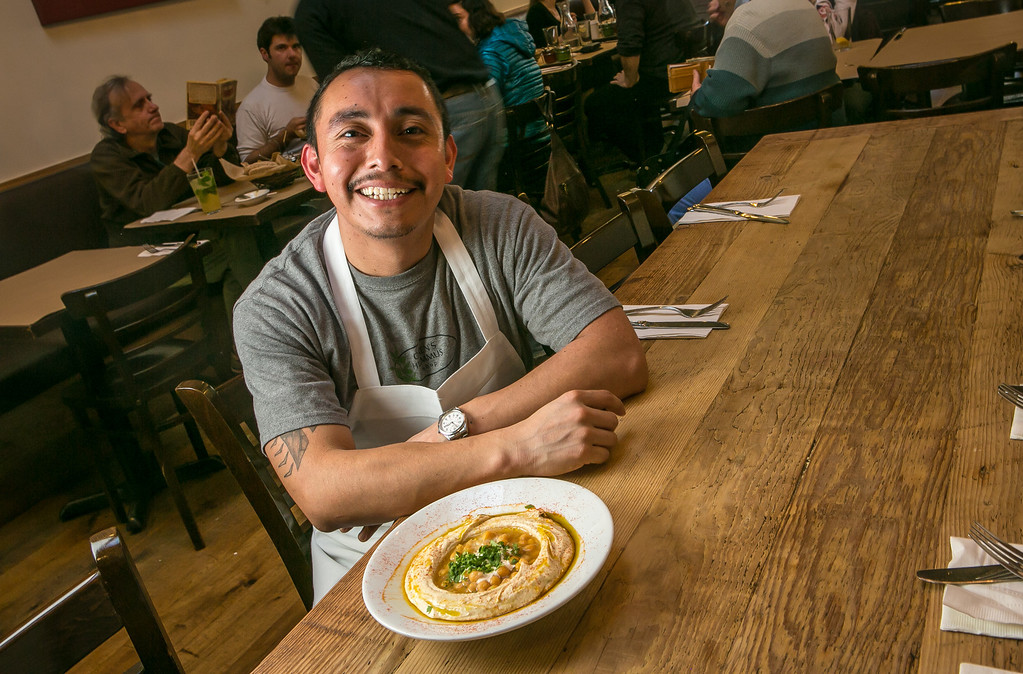 Chef Hipolito Gomez with a plate of Hummus at Oren's Hummus Shop in Palo Alto Calif. is seen on Friday, January 25th, 2013.