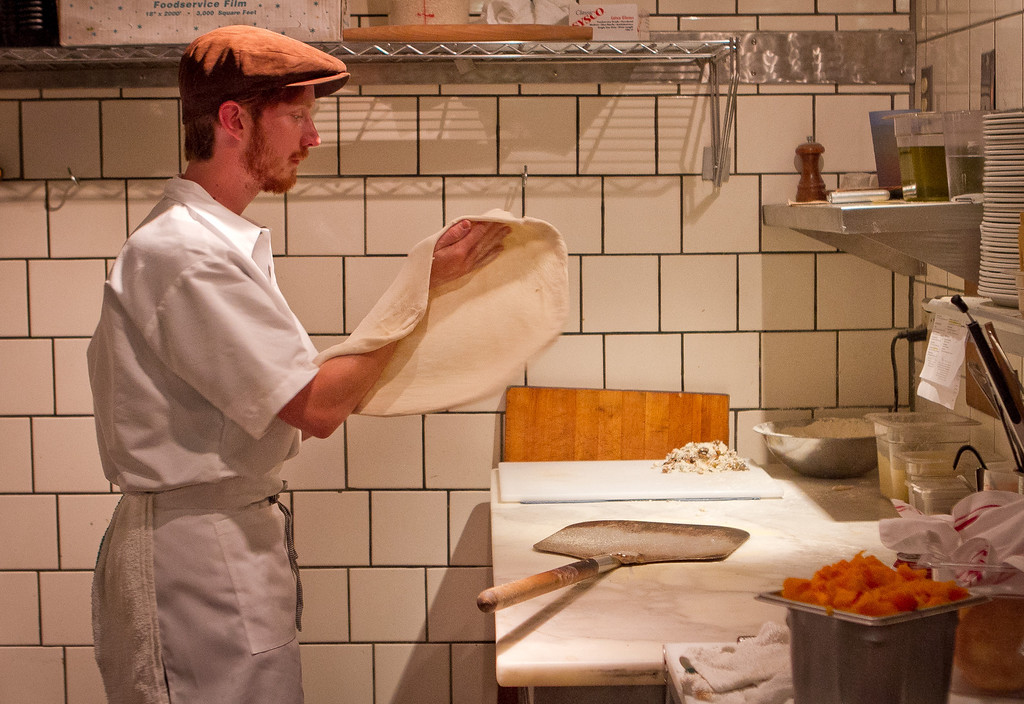 Cook Alex Rice prepares piazza at Origen restaurant in Berkeley, Calif., on Thursday, February 2, 2012.