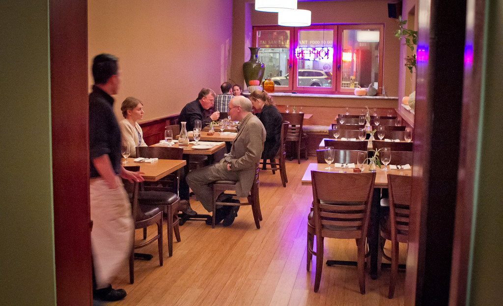 Diners enjoy dinner at Origen restaurant in Berkeley, Calif.,  on Thursday, February 2, 2012.