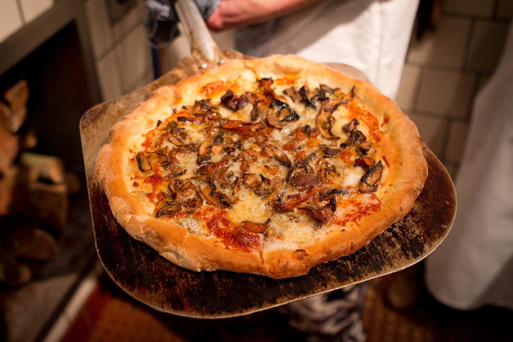 The Roasted Mushroom Pizza comes out of the wood fired oven at Origen restaurant in Berkeley, Calif., on Thursday, February 2, 2012.