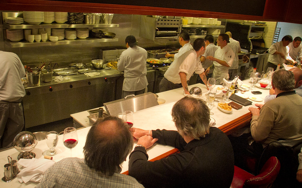 Diners watch the kitchen from the counter at Original Joe's Restaurant in San Francisco, Calif., on Thursday, January 26th, 2012.