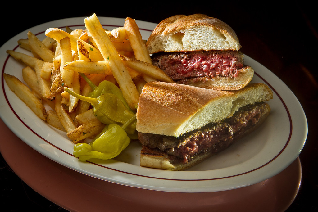 The Joe's Famous Hamburger Sandwich with Fries at Original Joe's Restaurant in San Francisco,  Calif., is seen on Tuesday, March 20th, 2012.