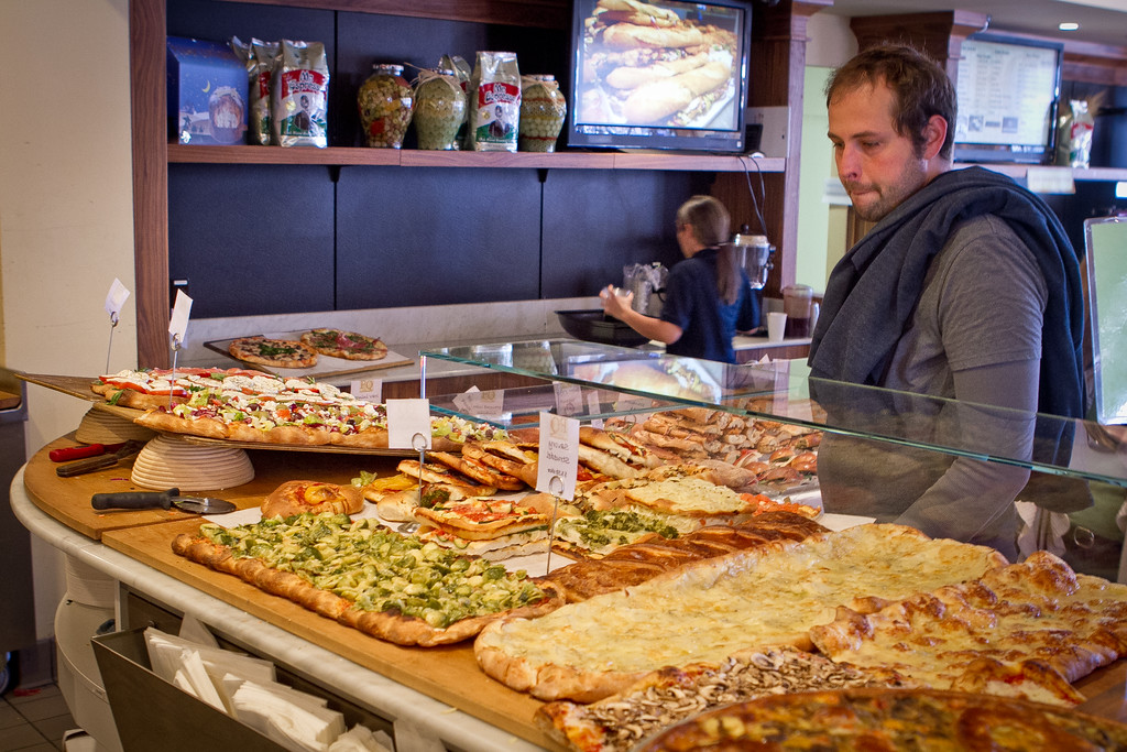 A customer looks over the pizza and Focacce at PIQ Cafe in Berkeley, Calif., on Friday, February 17th, 2012.