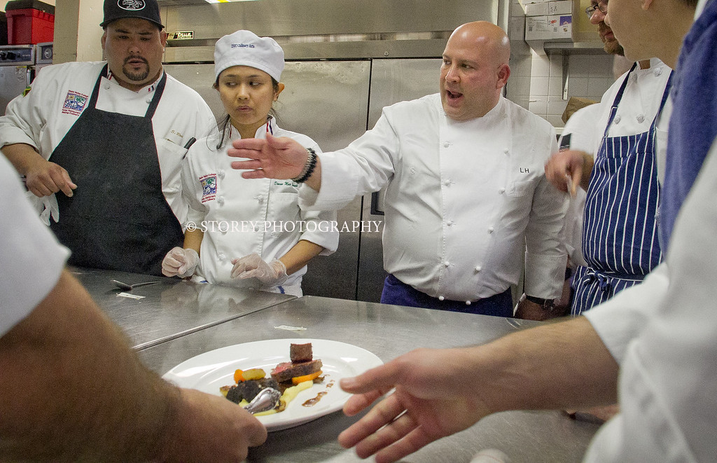 """Chef Lee Hefter of Spago points out how he wants his dish plated during the """"Stars of Los Angles"""" lunch during the Pebble Beach Food and Wine event in Pebble Beach, Calif. on Friday April 13h, 2012."""