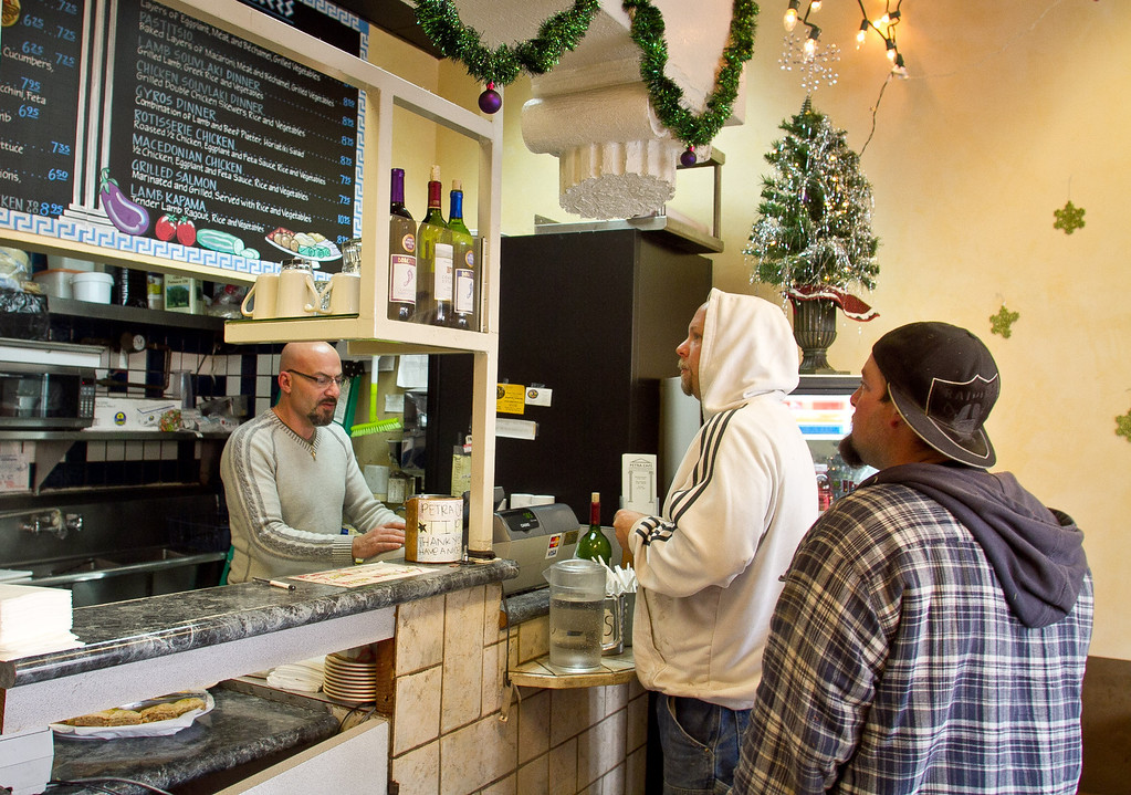 Customers order food at the Petra Cafe in Orinda, Calif., on Thursday, December 29th, 2011.