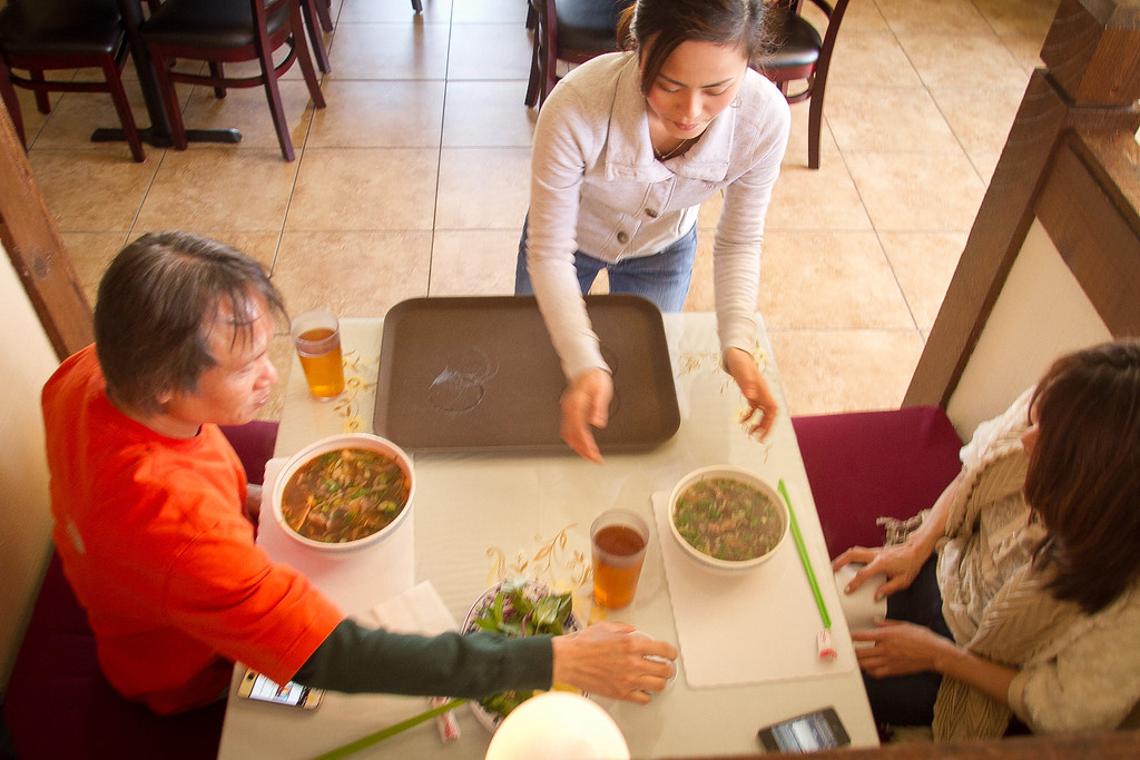 A server places a bowl of Pho for diners to enjoy for lunch at Pho Vet Restaurant in San Rafael, Calif., on Wednesday, March 7th, 2012.