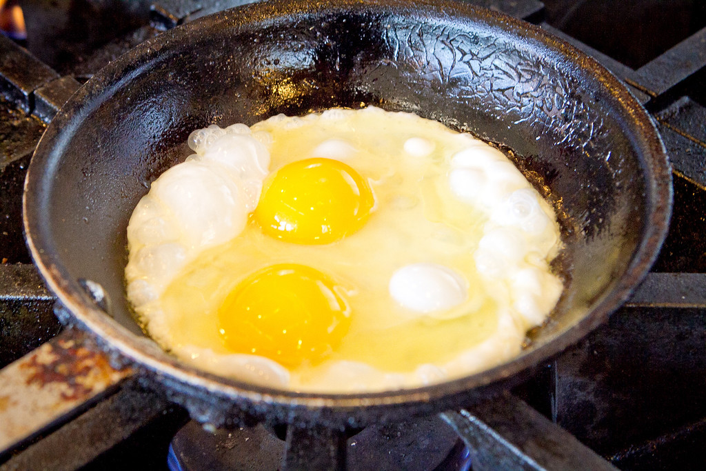 Eggs frying on the stove at Plow Restaurant in San Francisco, Calif., on Wednesday, January 24th, 2012.
