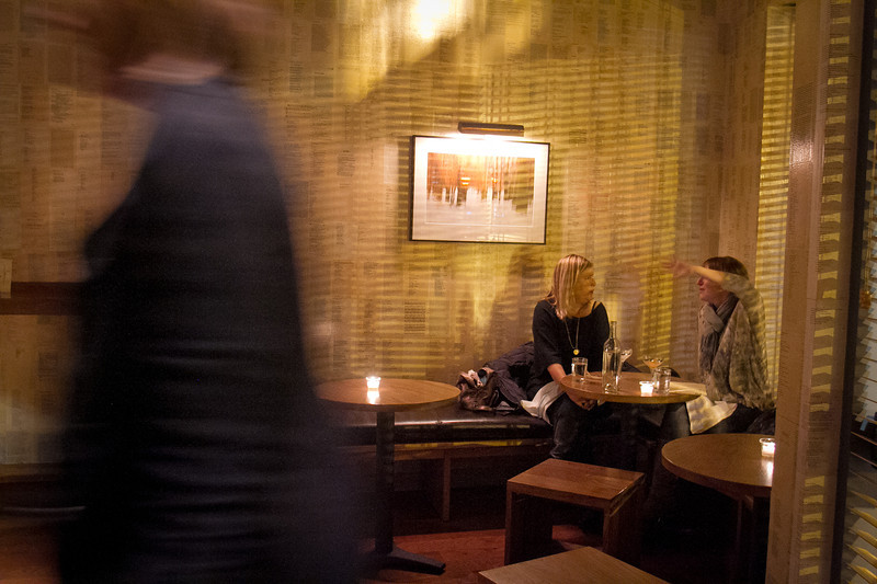 People enjoy cocktails at the Plum Bar in Oakland, Calif., on Thursday, January 19th, 2012.