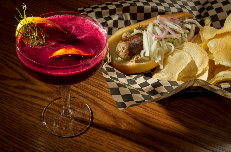 The San Franciscan cocktail with the Sausage sandwich at the Plum Bar in Oakland, Calif., is seen on Thursday, January 19th, 2012.