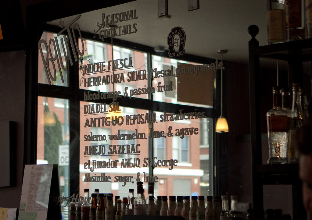 The cocktail menu on the bar mirror at Poquito restaurant in San Francisco,  Calif., is seen on Thursday, March 29th, 2012.