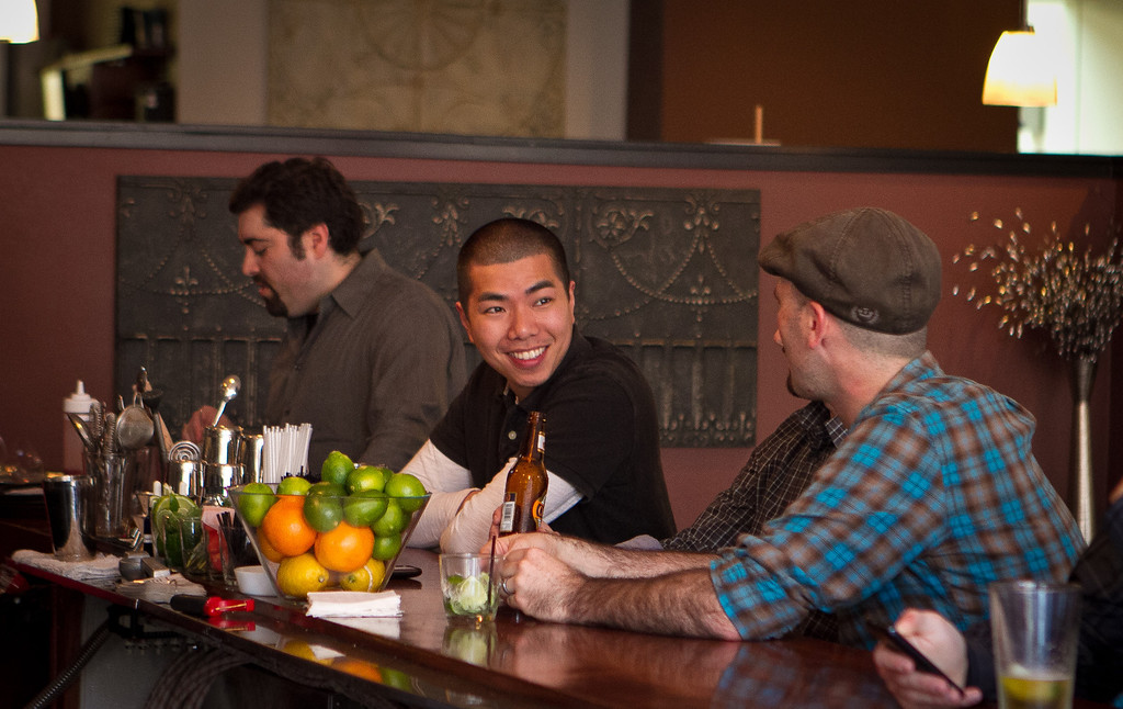 People enjoy happy hour at Poquito restaurant in San Francisco, Calif., on Thursday, March 29th, 2012.