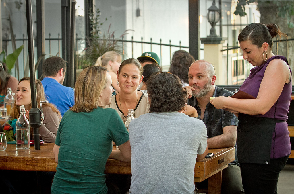 A server takes  drink order on the patio at Portal Oakland in Oakland, Calif., on Tuesday,  August 28th, 2012.