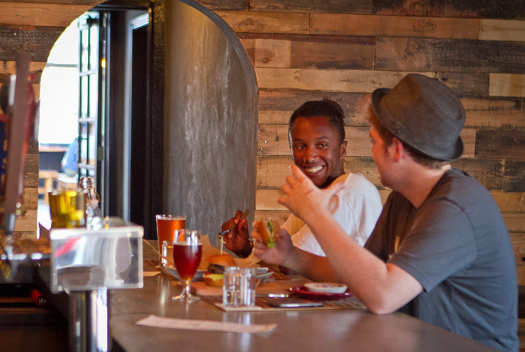 Customers enjoy happy hour at Portal Oakland in Oakland, Calif., on Tuesday,  August 28th, 2012.