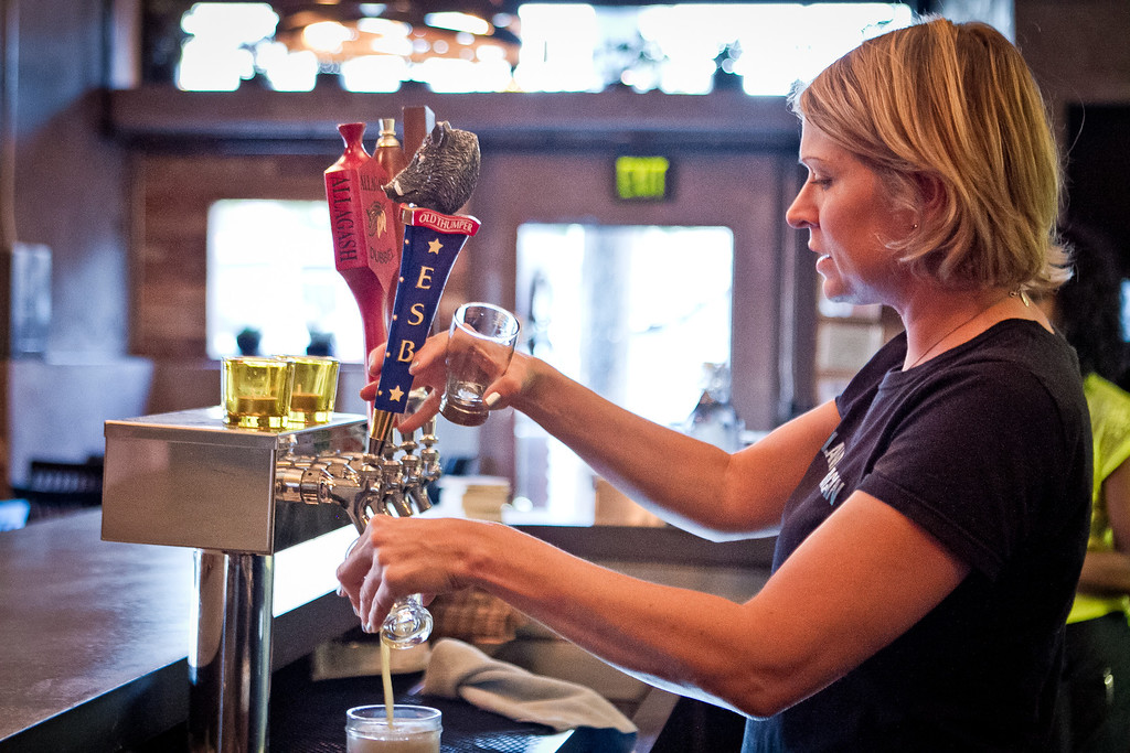 Bartender Sasha Zukanoff pours a beer at Portal Oakland in Oakland, Calif., on Tuesday,  August 28th, 2012.
